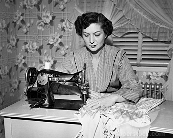 Mid adult woman sewing clothes with a sewing machine
